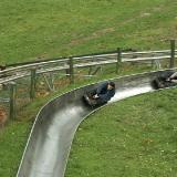 The toboggan runs at speeds of up to 40mph - Bobsledding